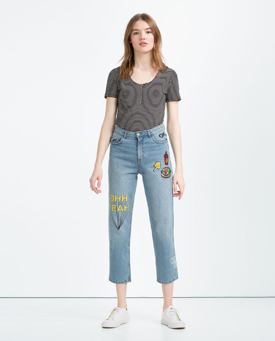 Pantalón denim con parches de Zara